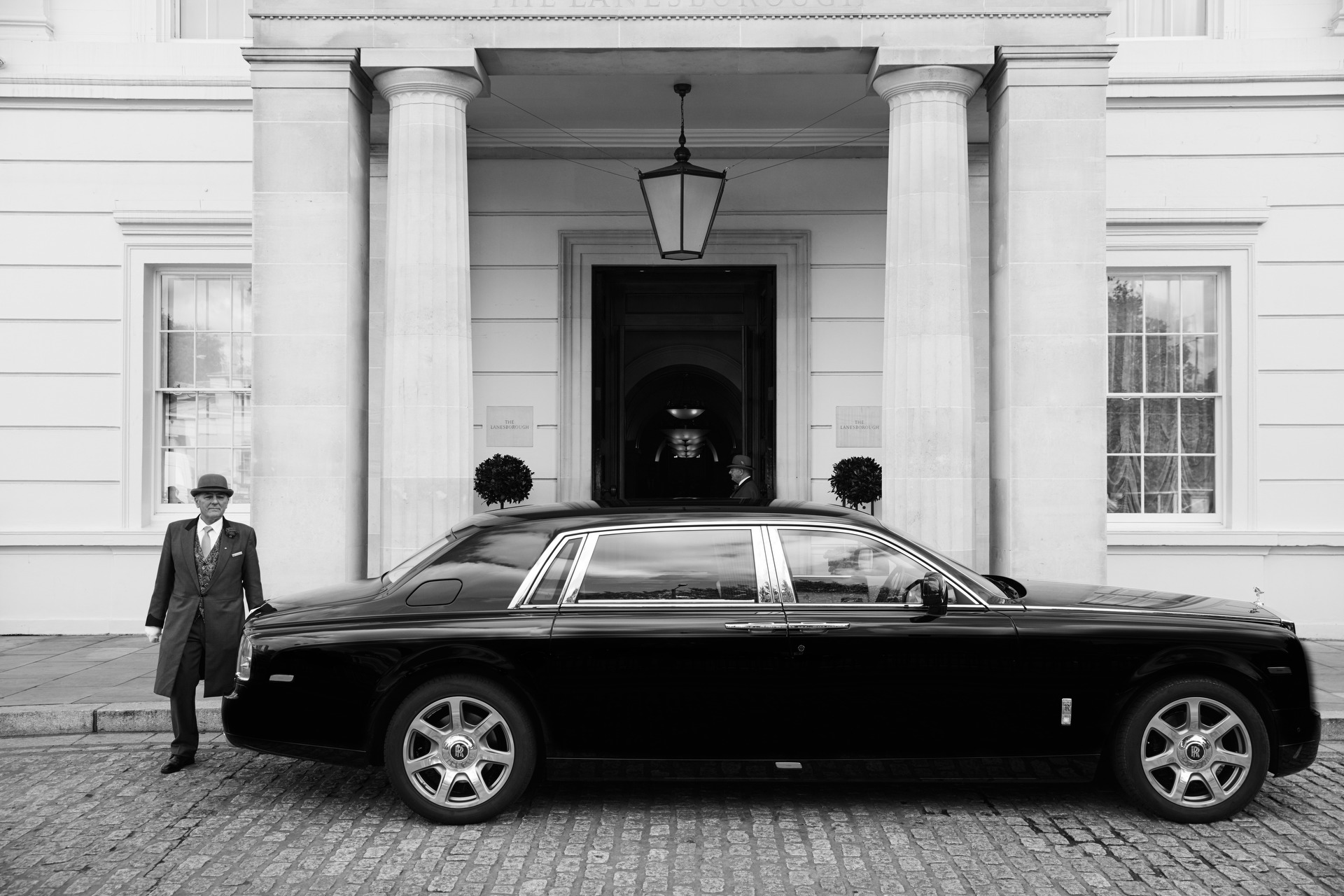 Doorman welcomes a guest in The Lanesborough Rolls Royce