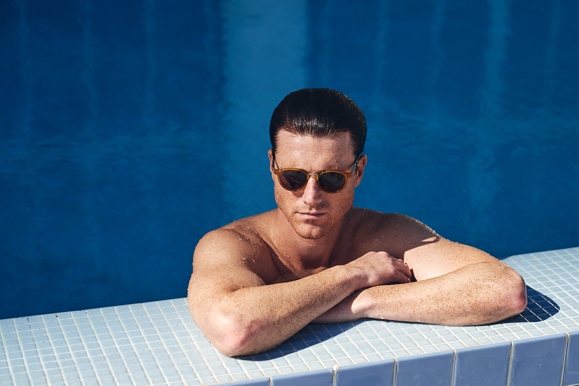 Man in the pool wear sunglasses at the Carillon Miami Lifestyle photography
