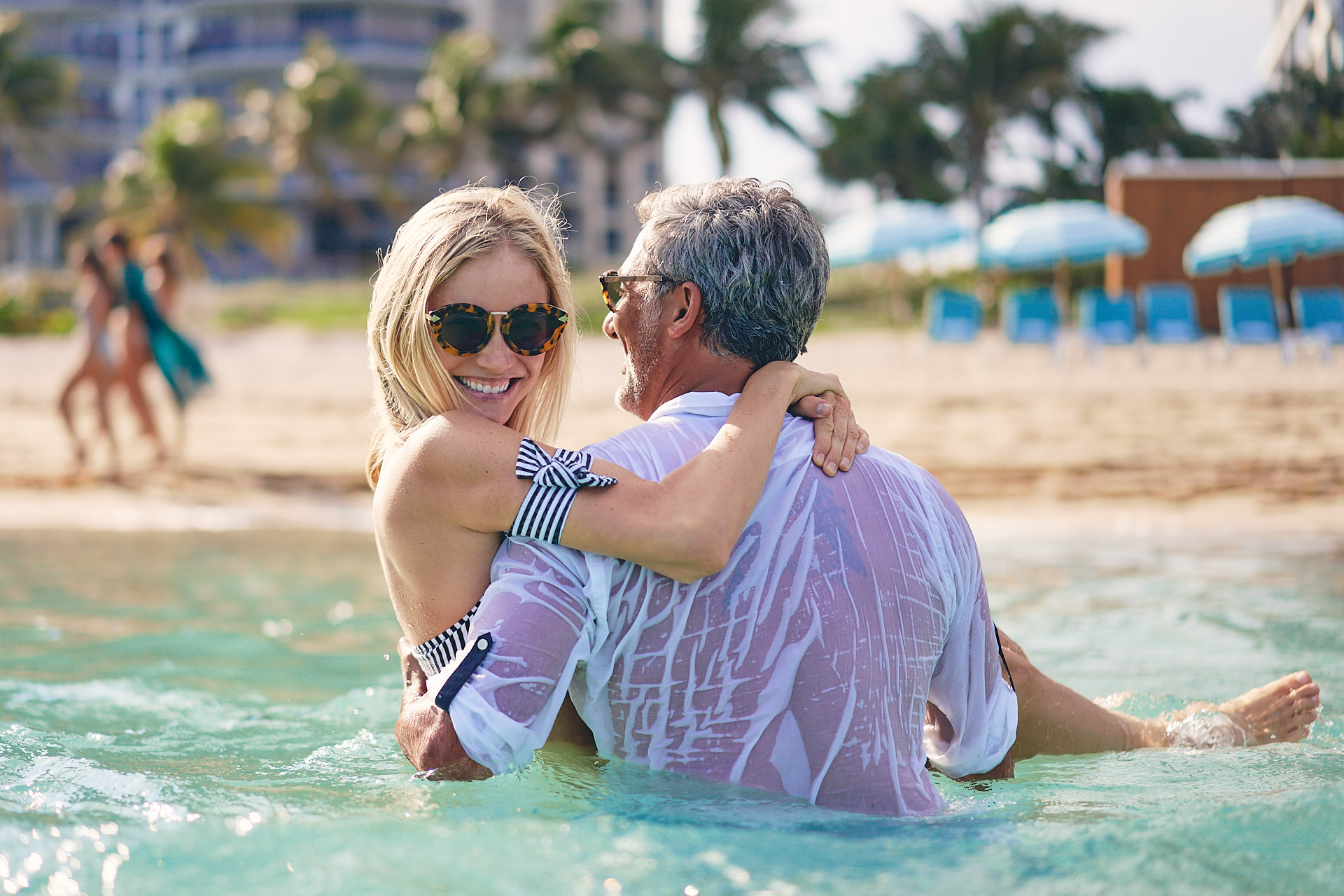 Couple in the sea outside the Carillon Miami Wedding Lifestyle Beach Fun