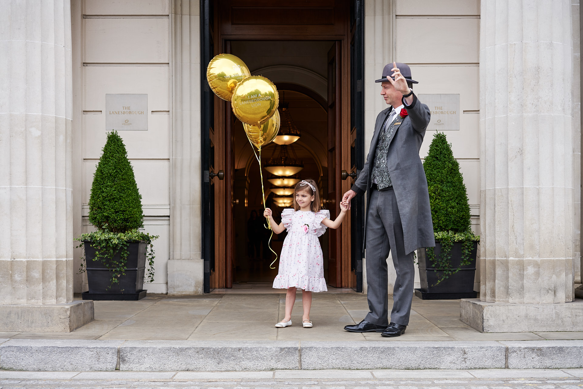 Children leaving The Lanesborough after a party