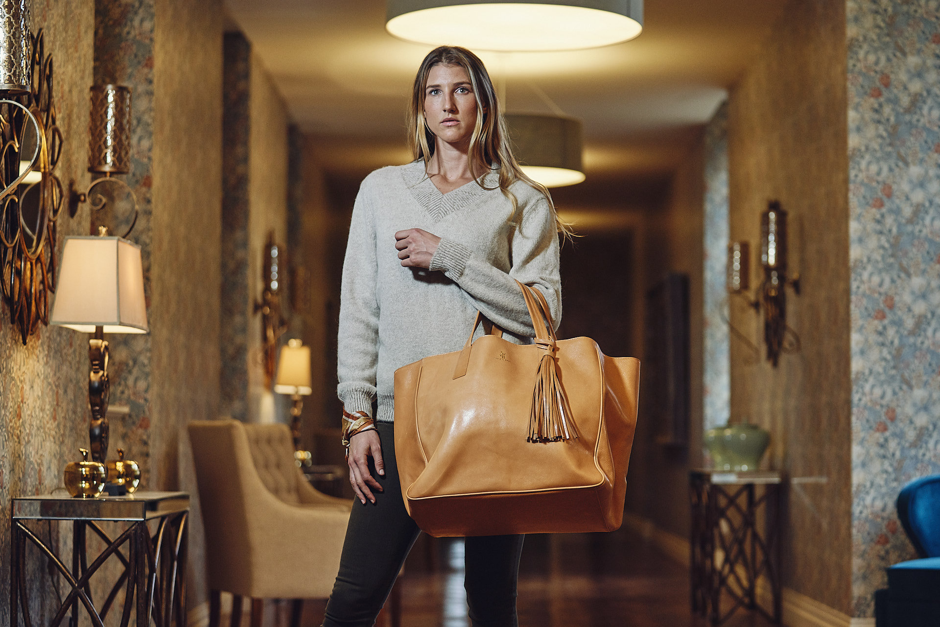 Model showing a leather bag designed by Stick & Ball English Photo Shoot