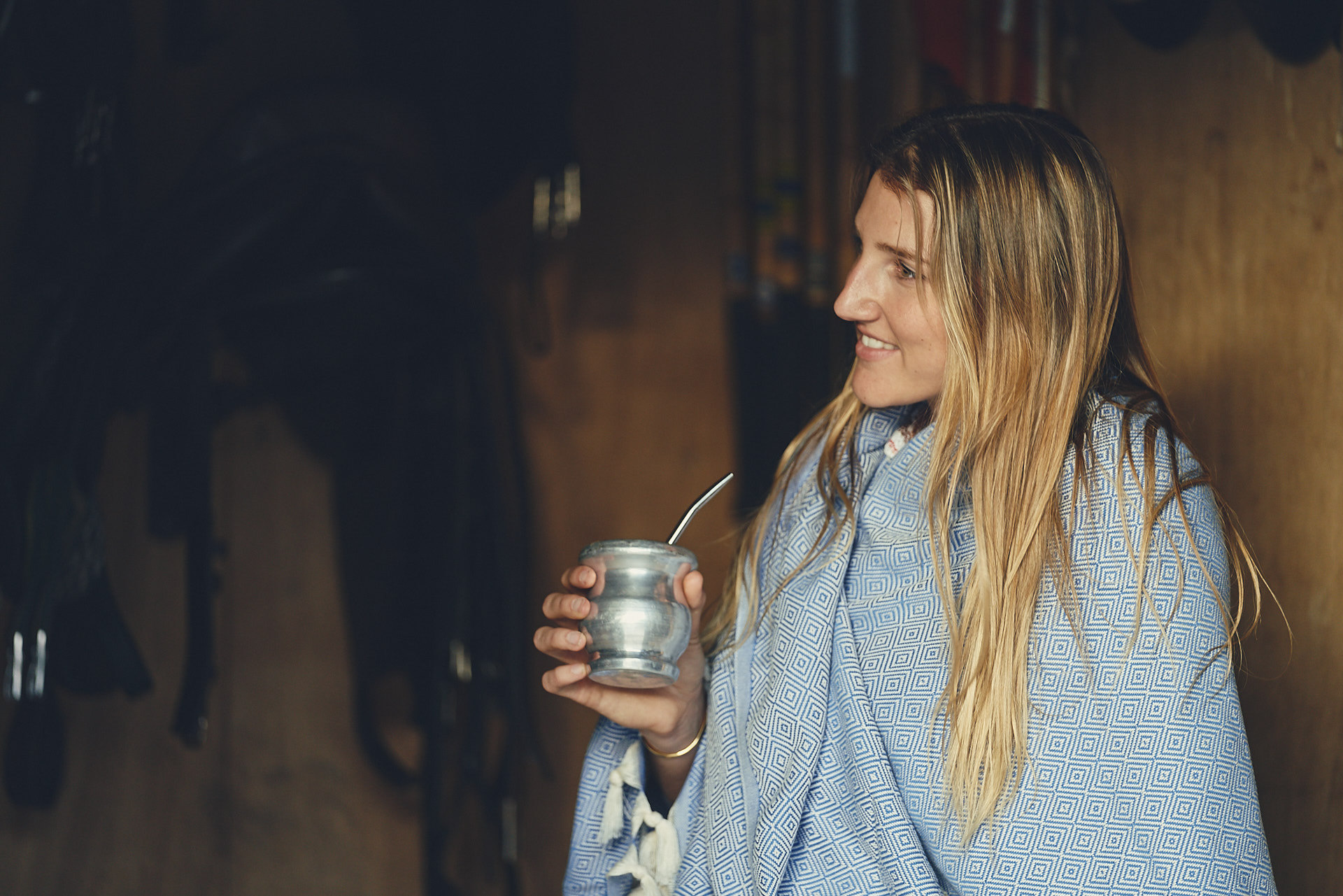 Girl sipping mate wearing a poncho Stick & Ball English Photo Shoot